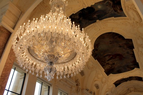 Baccarat Chandelier against the ceiling of the Petit Palais